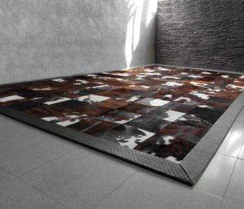 Natural Cavallino area rug with woven leather border
